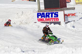 Two snowmobiles coming to finish line — Stock Photo