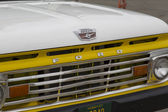 1970's Yellow U.S. Flag Ford Truck Grill View — Stock Photo