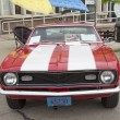 Постер, плакат: Red and White 1968 Chevy Camaro 327 Front View