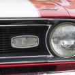 Постер, плакат: Red and White 1968 Chevy Camaro 327 Headlamp