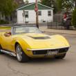 Постер, плакат: Yellow 1968 Chevy Corvette Roadster Driving