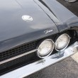 图库照片: 1970 Ford Torino Cobrblack Car headlights