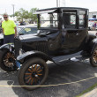 图库照片: Black Ford Model T Car Side View