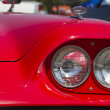 Stock Photo: 1960 Red Ford Thunderbird headlight