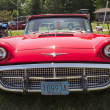 Stock Photo: 1960 Red Ford Thunderbird hardtop convertible Front View