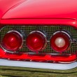 Stock Photo: 1960 Red Ford Thunderbird hardtop convertible tail light