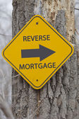 Reverse Mortgage Arrow sign on tree — Stock Photo