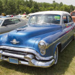 Stock Photo: Blue Oldsmobile Ninety Eight