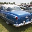 Stock Photo: Blue Oldsmobile Ninety Eight Rear View
