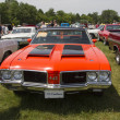 Stock Photo: 1972 Red with black stripes Olds Cutlass
