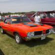 Stock Photo: 1972 Red with black stripes Olds Cutlass Side View