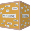 Stock Photo: Investments 3D cube Corkboard Word Concept
