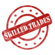 Foto Stock: Red Weathered Skilled Trades Stamp Circles and Stars