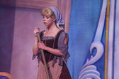 Cinderella in rags with broom — Stock Photo