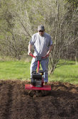 Man gardening with Rototiller — Stock Photo