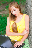 Close- up portrait of a girl with laptop on the nature — Stock Photo