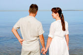 Sweethearts looking at the sea — Stock Photo