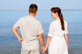 Sweethearts looking at the sea — Stock Photo