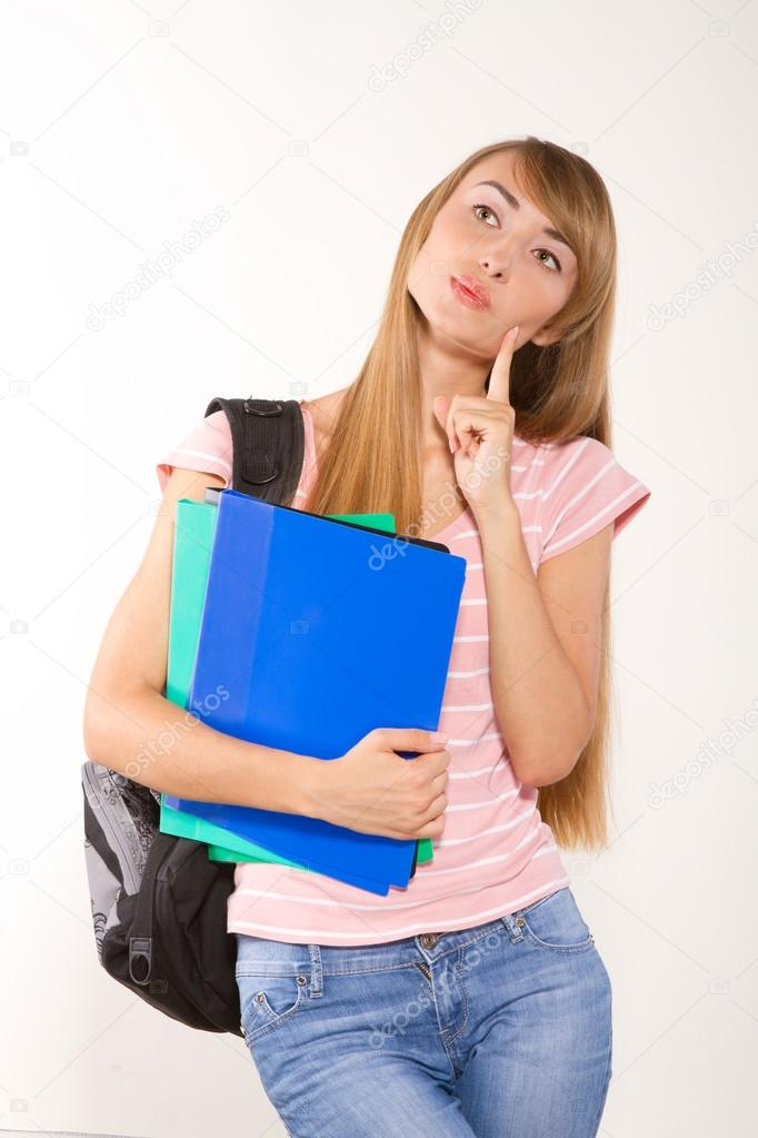 Graceful female student with books in hands looking at camera. — Stock Photo #12082451
