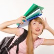 Female student with books on head — Stock Photo #12101133