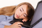 Young businesswoman sleeping on the laptop — Stock Photo