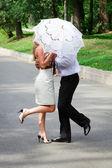 Love couple under an umbrella — Stock Photo