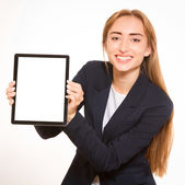 Young woman showing a tablet PC. — Stock Photo
