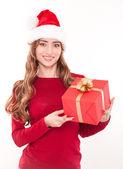 Smiling christmas woman with gift — Zdjęcie stockowe