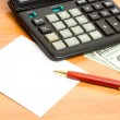 Pen, calculator and money close up. — Foto de Stock