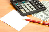 Pen, calculator and money close up. — Stock Photo