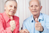 Smiling elderly couple — Stock Photo