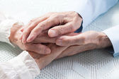 Old hands holding each other — Stock Photo