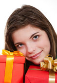 Happy girl holding gifts — Stock Photo