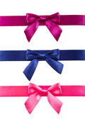 Colored ribbons with bows on white background. — Stock Photo