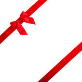 Red ribbon with bow on white background — ストック写真