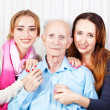 Senior man with her caregiver at home — Stock Photo