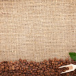 Coffee beans on burlap background — Stock Photo #18923311