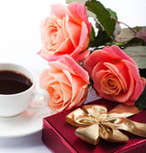 Flowers, cup of coffee and sweets. — Stock Photo