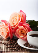 Flowers, cup of coffee — Stock Photo