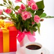 Flowers, coffee and gift box. — Photo