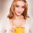 Portrait of cute woman drinking tea or coffee. — Stock Photo