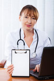 Doctor working in hospital — Stock Photo