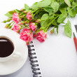 Stock Photo: Flowers, coffee and notebook.