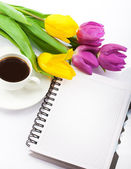Flowers, coffee and notebook. — Stock Photo