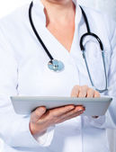 Doctor working with tablet, — Stock Photo