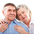 Closeup portrait of smiling elderly couple — Stock Photo #21011613
