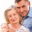 Closeup portrait of smiling elderly couple — Stock Photo #21060683