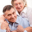 closeup portrait of smiling elderly couple — Stock Photo