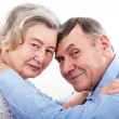 closeup portrait of smiling elderly couple — Stock Photo #22266061