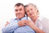 Closeup portrait of smiling elderly couple — Stock Photo